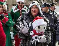 NEW YORK, NY - December 10: A woman gather near to the Flat Iron building during the annual SantaCon event in New York City December 10,2016. VIEWpress/Maite H. Mateo