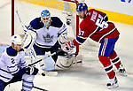 10 April 2010: Toronto Maple Leafs' goaltender Jean-Sebastien Giguere makes a second period save on Montreal Canadiens' left wing forward Benoit Pouliot at the Bell Centre in Montreal, Quebec, Canada. The Maple Leafs defeated the Canadiens 4-3 in sudden death overtime. Mandatory Credit: Ed Wolfstein Photo