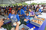 Duke faculty and staff line up for a pre-game meal in front of Cameron Indoor Stadium during the Employee Kickoff Celebration and season opener against North Carolina Central University. Duke won the game 49-6 at the newly renovated Brooks Field at Wallace Wade Stadium.
