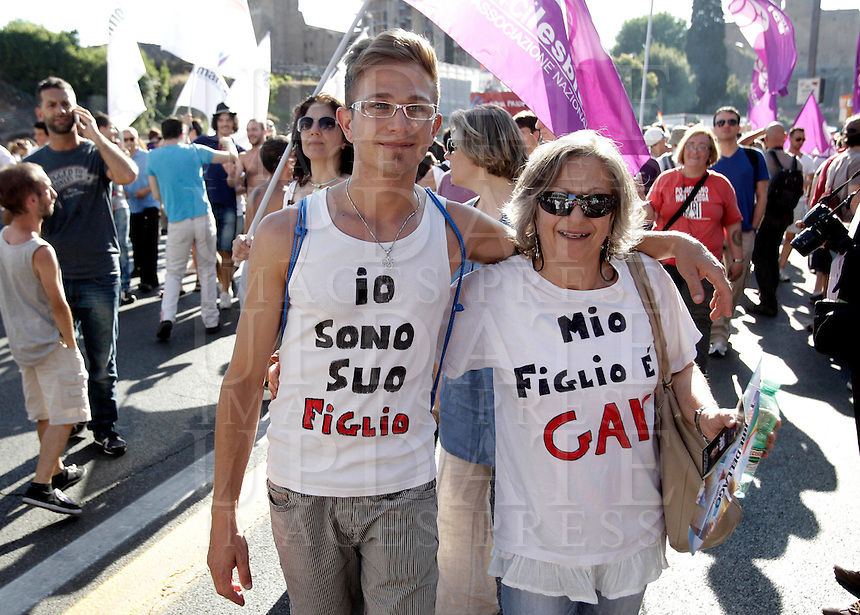 "Partecipanti al Gay Pride, Roma, 23 giugno 2012..Demonstrators wear t-shirts reading ""I am her son"". left, and ""My son is gay"" during the Gay Pride in Rome, 23 june 2012..© Riccardo De Luca"