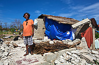 A woman posing in from of her house that was destroyed by Tyhpoon Yolanda. The people here area amazing, even after losing almost everything they continue live with a smile and try to rebuild there lives