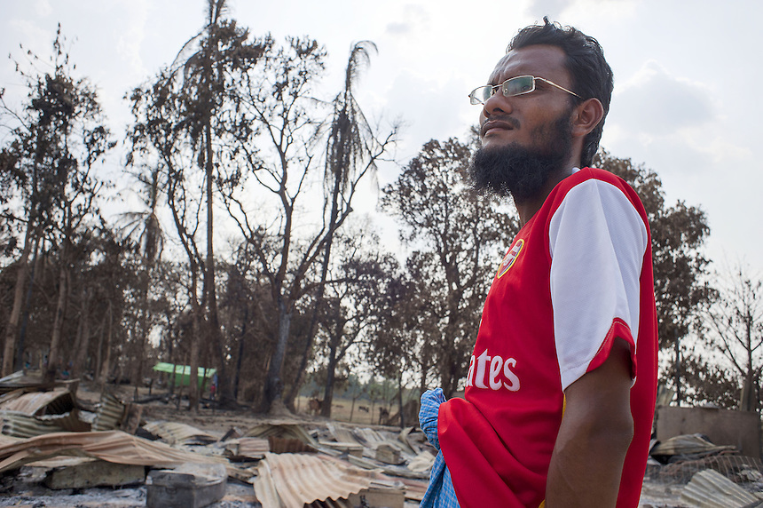 Habi Moliwi, the iman of the destroyed  Kyawe Pone Lay village in Oakkan Township, stands next to what was the community recreational centre. The village was attacked by a mob, some of which they knew by name, in the early evening on April 30. Following the attack, 100 of the 500 residents have fled to Yangon.