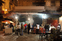 """Vucciria at night, oldest market of Palermo, Piazza Caracciolo, Sicily, Italy. The name probably derives from the word ?Bucceria?, which in turn comes from the French """"boucherie"""", which means butcher. The Vucciria originally was dedicated primarily to the sale of meat. Picture by Manuel Cohen"""
