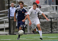 HYATTSVILLE, MD - OCTOBER 26, 2012:  Christian Cooke (7) of DeMatha Catholic High School goes for a loose ball with Camyer Matini (5) of St. Albans during a match at Heurich Field in Hyattsville, MD. on October 26. DeMatha won 2-0.