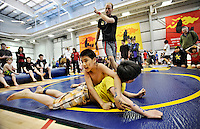 Ian Stewart/Yukon News<br /> Matthew Macintosh of Hidden Valley wrestles with Tyler Blanchard of Holy Family during the Yukon Elementary Wrestling Championship on Wednesday at the Canada Games Centre.