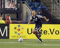 New England Revolution forward Ilija Stolica (9) brings the ball forward. The New England Revolution tied Columbus Crew, 2-2, at Gillette Stadium on September 25, 2010.