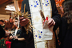 Blessing Badnjak (blessing of the Yule Logs) following Christmas Eve Vigil Service, St. Sava Serbian Orthodox Church, Jackson, Calif...Fr. Steve holds straw representing the straw in the manger where Christ was born.