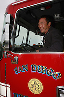 May, Point Loma San Diego, CA, USA.  Fire fighter- Paramedic  Kevin Wakashige poses in the  brand new fire truck that he drives while working at Fire Station 22 in Point Loma.  The station took delivery of one of eight brand new 2007 KME Predator Type I Fire Engines that San Diego ordered in 2007.  Each truck, built in Nesquehoning, PA costs roughly $582K including communications, firefighting and medical equipment.