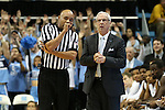30 December 2015: Referee Bill Covington Jr. (left) talk with UNC head coach Roy Williams (right). The University of North Carolina Tar Heels hosted the Clemson University Tigers at the Dean E. Smith Center in Chapel Hill, North Carolina in a 2015-16 NCAA Division I Men's Basketball game. UNC won the game 80-69.