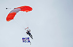 14 September 2014: An Aerial Skydiver glides down to the field prior to a game against the Miami Dolphins at Ralph Wilson Stadium in Orchard Park, NY. The Bills defeated the Dolphins 29-10 to win their home opener and start the season with a 2-0 record. Mandatory Credit: Ed Wolfstein Photo *** RAW (NEF) Image File Available ***