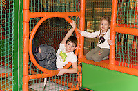 Happy Caucasian Kids Sitting on Children Playground Climbing Web
