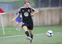 BOYDS, MARYLAND - July 21, 2012:  Ashley Herndon (15) of DC United Women crosses the ball against the Virginia Beach Piranhas during a W League Eastern Conference Championship semi final match at Maryland Soccerplex, in Boyds, Maryland on July 21. DC United Women won 3-0.
