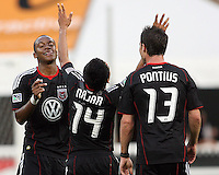 Chris Pontius #13, Rodney Wallace #22 of D.C. United after Andy Najar #14 had scored the first goal during an MLS match against Chivas USA at RFK Stadium, on May 29 2010 in Washington DC. United won 3-2.