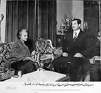 "January 19, 1975, location unknown, Saddam Hussein meets India prime minister Indira Gandhi..Photograph recovered by Bruno Stevens in the looted ""Triumphant Leader"" museum in Baghdad, entirely dedicated to the glory of Saddam Hussein."
