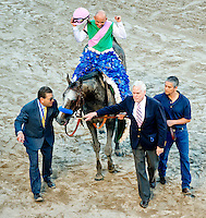 HALLANDALE BEACH, FL - JAN 28: Assistant Trainer Jimmy Barnes and Juddmonte Farm's Dr. John Chandler lead Arrogate #1, ridden by Mike Smith, into the winner's circle after he won the $12,000,000 Pegasus World Cup Invitational the Pegasus World Cup Invitational Day at Gulfstream Park Race Course on January 28, 2017 in Hallandale Beach, Florida. (Photo by Scott Serio/Eclipse Sportswire/Getty Images)