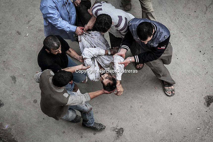 In this Tuesday, Oct. 23, 2012 photo. A Syrian civilian is driven into a hospital in Tarik Al-Bab after he was injured by mortar shelling when he was buying bread at one bakery in Hananu district, at the northeast of Aleppo City. (AP Photo/Narciso Contreras).