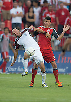 18 July 2012: Colorado Rapids forward Conor Casey #9 and Toronto FC defender Logan Emory #2 in action during an MLS game between the Colorado Rapids and Toronto FC at BMO Field in Toronto..Toronto FC won 2-1..