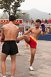 Students of Tagou Shaolin martial arts school practicing Sanda Chinese boxing at the opening ceremony of Zhengzhou International Wushu Fetival in DengFeng, Henan, China 2014