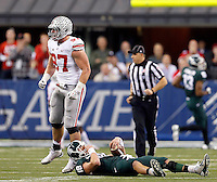 Ohio State Buckeyes defensive lineman Joey Bosa (97) reacts after sacking Michigan State Spartans quarterback Connor Cook (18) during the first half of the Big Ten Championship football game at Lucas Oil Stadium in Indianapolis on Friday, December 7, 2013. (Columbus Dispatch photo by Jonathan Quilter)
