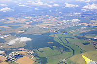 Aerial view of fields and green lands from a window of a window