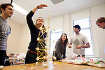 "02/28/2012- Somerville, Mass. - Polly Murray, E14, measures the height of her group's winning spaghetti and marshmallow tower for the civil engineers Engineering Week ""Tallest Structure"" activity on Feb. 28, 2012. (Kelvin Ma/Tufts University)"