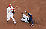 31 March 2011: Washington Nationals shortstop Ian Desmond doubles off a sliding Chipper Jones during Opening Day action against the Atlanta Braves at Nationals Park in Washington, District of Columbia. The Braves shut out the Nationals 2-0 to start off the 2011 Major League Baseball season. Mandatory Credit: Ed Wolfstein Photo