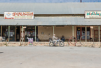 Terlingua Store and two guys chatting on the porch on this day.