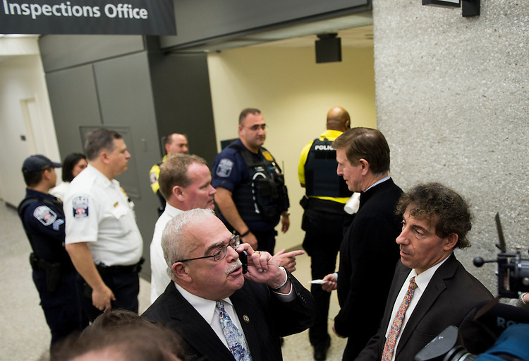 UNITED STATES - JANUARY 29: From left, Rep. Gerry Connolly, D-Va., speaks with a U.S. Customs and Border Protection liaison on the phone as he along with Rep. Don Beyer, D-Va., and Rep. Jamie Raskin, D-Md., try to determine if any international travelers are detained without legal access at Dulles International Airport in Virginia on Sunday, Jan. 29, 2017. Protests erupted at airports around the country following President Trump's executive order restricting travel from several Islamic countries. (Photo By Bill Clark/CQ Roll Call)