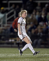 """Boston College midfielder Julia Bouchelle (12) scores Boston College's second goal of the match. Boston College defeated West Virginia, 4-0, in NCAA tournament """"Sweet 16"""" match at Newton Soccer Field, Newton, MA."""