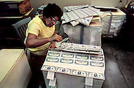 Oct 1971, Washington DC. Making of the dollar in the Bureau of Engraving and Printing.  Employees checking for imperfections and right colors.