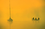 3 men in a boat - Sunrise through foggy mist,  Crystal Lake, CT