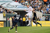 Danny Allsopp (9) of D. C. United and Danny Califf (4) of the Philadelphia Union go up for a header. during a Major League Soccer (MLS) match at Lincoln Financial Field in Philadelphia, PA, on April 10, 2010.