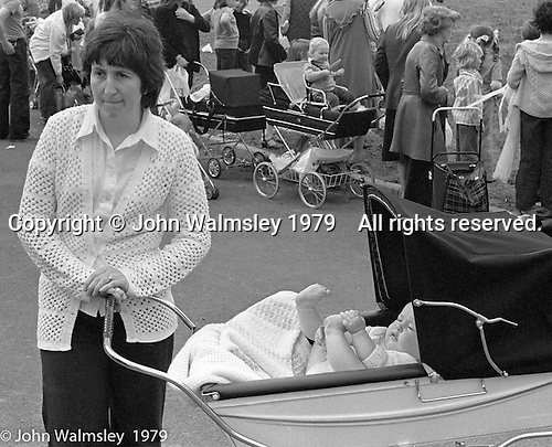 Mums and prams at the Education Centre, Festival & Gala Day, Wester Hailes, Scotland, 1979.  John Walmsley was Photographer in Residence at the Education Centre for three weeks in 1979.  The Education Centre was, at the time, Scotland's largest purpose built community High School open all day every day for all ages from primary to adults.  The town of Wester Hailes, a few miles to the south west of Edinburgh, was built in the early 1970s mostly of blocks of flats and high rises.
