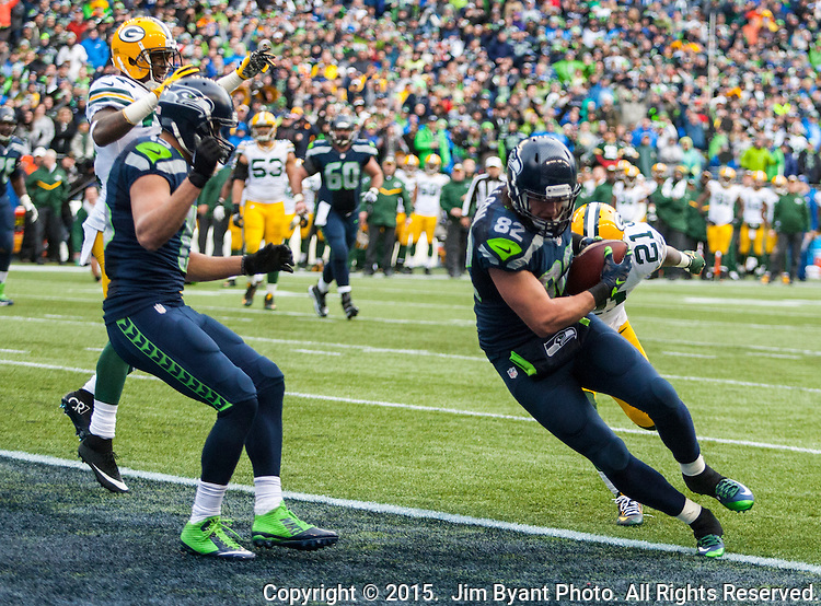 Seattle Seahawks tight end Luke Willson (82) catches a two-point conservation against  Green Bay Packers  safety Ha Ha Clinton-Dix (21) during the NFC Championship game at CenturyLink Field in Seattle, Washington on January 18, 2015.  The Seattle Seahawks beat the Green Bay Packers in overtime 28-22 for the NFC Championship Seattle.  ©2015. Photo by Jim Bryant. All Rights Reserved.