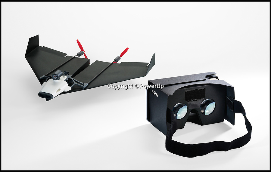 BNPS.co.uk (01202 558833)<br /> Pic: PowerUp/BNPS<br /> <br /> A former pilot has launched the world's first drone made from a paper aeroplane that boasts an onboard live-streaming camera so users can imagine they are sat in its 'cockpit'.<br /> <br /> Shai Goitein wanted everyone to be able to experience the thrill of flying a plane - so he invented a simple paper aeroplane gadget that comes with its own camera and virtual reality headset.<br /> <br /> Mr Goitein is hoping his new invention, called The PowerUp FPV, will take off after launching a campaign to fund it on Kickstarter.<br /> <br /> The gadget can be pre-ordered for $159 - around &pound;100 - and more than &pound;120,000 has already been pledged in support.