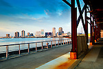 The skyline of New Orleans and a portion of a steel frame from an old factory building are seen in the newly developed Crescent Park on the banks of the Mississippi River in New Orleans.