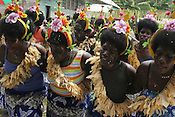 """school closing"" festivities and life on Han Island, Carterets Atoll, Papua New Guinea, on Monday, Dec. 11, 2006. Rising sea levels have eroded much of the coastlines of the low lying Carteret islands (situated 80km from Bougainville island, in the South Pacific), and waves have crashed over the islands flooding and destroying what little crop gardens the islanders have. Food is in short supply, banana and swamp taro crops are failing due to the salt contamination of the land, and the islanders live on a meagre one meal per day diet of fish and coconut. There is talk by the Autonomous Region of Bougainville government to relocate the Carteret Islanders to Bougainville island, but this plan is stalled due to a lack of finances, resources, land and coordination."