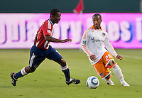 CARSON, CA – July 23, 2011: Chivas USA midfielder Michael Lahoud (11) and Houston Dynamo defender Corey Ashe (26) during the match between Chivas USA and Houston Dynamo at the Home Depot Center in Carson, California. Final score Chivas USA 3, Houston Dynamo 0.