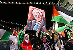 Palestinians celebrate following the Palestinian President Mahmoud Abbas' speech at the General Assembly at the United Nations, in the West Bank city of Ramallah on September 30, 2015. Demonstrating a new level of tension with Israel, Abbas declared Wednesday that it was no longer bound by the 1995 Oslo Accords that formed the basis for a two-state solution to the Israeli-Palestinian conflict. Photo by Shadi Hatem