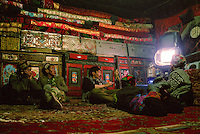 Sufi's place is one of the rare one to have a solar panel with a chinese battery to power enough electricity to run a DVD player and watch such things as karate film made in Kabul..Campment of Ortobil (Sufi), all the way at the end of the Little Pamir, near the Tajik/China border. .Winter expedition through the Wakhan Corridor and into the Afghan Pamir mountains, to document the life of the Afghan Kyrgyz tribe. January/February 2008. Afghanistan