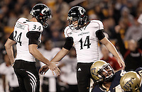PITTSBURGH, PA - NOVEMBER 05:  Tony Miliano #14 of the Cincinnati Bearcats is congratulated by teammate Pat O'Donnell #34 after kicking a field goal against the Pittsburgh Panthers on November 5, 2011 at Heinz Field in Pittsburgh, Pennsylvania.  (Photo by Jared Wickerham/Getty Images)