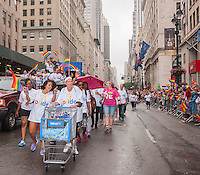 Walmart employees and supporters in the annual Lesbian, Gay, Bisexual and Transgender Pride Parade on Fifth Avenue in New York on Sunday, June 28, 2015. The parade was particularly boisterous due to the recent Supreme Court decision on same-sex marriage. The parade is the largest gay pride parade in the world.(© Richard B. Levine)
