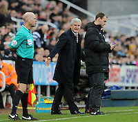 Mark Hughes manager of Stoke City protests to the fourth official Robert Madley