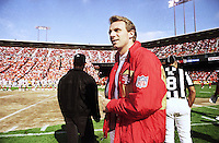 San Francisco 49ers quarterback Joe Montana walks onto the field in street clothes prior to the 49ers matchup with the Seattle Seahawks at Candlestick Park in San Francisco, Friday, August 28, 1992. (Photo by Alan Greth)