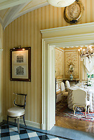 View from the corridor into the dining room which is decorated with hand-painted wall panels