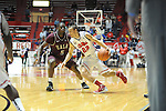 "Mississippi's Marshall Henderson (22) dribbles against Arkansas Little Rock's Kemy Osse (5) at the C.M. ""Tad"" Smith Coliseum in Oxford, Miss. on Friday, November 16, 2012. (AP Photo/Oxford Eagle, Bruce Newman)"