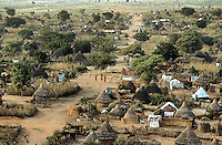 Sudan. West Darfur. Kerenek. Overall view at sunset on the village. Traditional african huts. © 2004 Didier Ruef