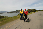 Couple on Segways, each on a Segway, on Angel Island State Park in San Francisco Bay, California, CA. Model released..Photo camari211-70529..Photo copyright Lee Foster, www.fostertravel.com, 510-549-2202, lee@fostertravel.com.