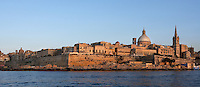 Panoramic view of Valletta,  Malta from the sea, featuring the dome of the Carmelite Church, 1573, and spire of St Paul's Anglican Pro-Cathedral, 1839-44, pictured on June 6, 2008, in the evening. The Republic of Malta consists of seven islands in the Mediterranean Sea of which Malta, Gozo and Comino have been inhabited since c.5,200 BC. Nine of Malta's important historical monuments are UNESCO World Heritage Sites, including  the capital city, Valletta, also known as the Fortress City. Built in the late 16th century and mainly Baroque in style it is named after its founder Jean Parisot de Valette (c.1494-1568), Grand Master of the Order of St John. The Carmelite church was originally built by Gerolamo Cassar, and rebuilt after bomb damage during World War II.  St Paul's Anglican Pro-Cathedral was designed by William Scamp. Picture by Manuel Cohen.