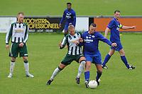 VOETBAL: JOURE: Sportpark de Hege Simmerdyk, 11-05-2014, SC Joure - VV Hoogeveen uitslag 3-3, Niklas Tarvaj‰rvi (SC Joure) in duel met Guido ten Cate, ©foto Martin de Jong